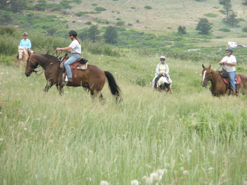 Sue Potter and Ann Coleman trail riding on our ranch
