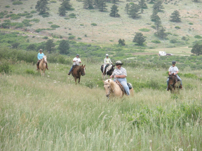 Kim on Prince leading a trail ride on our ranch