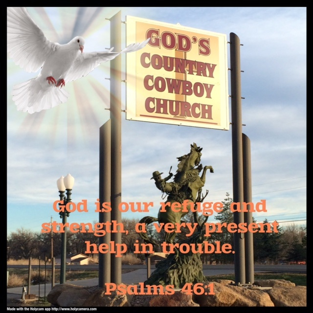 God's Country Cowboy Church sign with bucking bronco statue below it