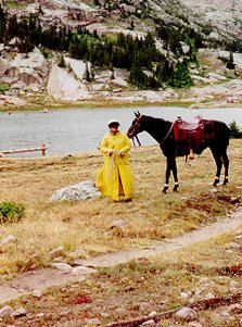 Kim wearing slicker with Chance at Lawn Lake RMNP